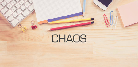 chaos: Business Workplace with  CHAOS Concept on Wooden Background