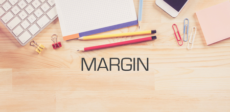 margin: Business Workplace with  MARGIN Concept on Wooden Background