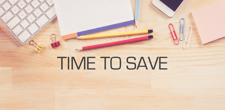 frugality: Business Workplace with  TIME TO SAVE Concept on Wooden Background Stock Photo