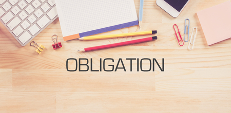 obliged: Business Workplace with  OBLIGATION Concept on Wooden Background Stock Photo
