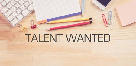 human potential: Business Workplace with  TALENT WANTED Concept on Wooden Background