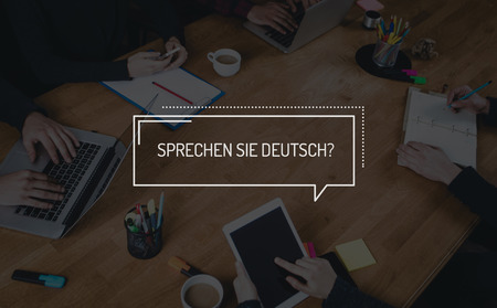 deutsch: BUSINESS TEAMWORK WORKING OFFICE BRAINSTORMING SPRECHEN SIE DEUTSCH? CONCEPT