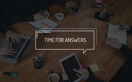 answers concept: BUSINESS TEAMWORK WORKING OFFICE BRAINSTORMING TIME FOR ANSWERS CONCEPT Stock Photo