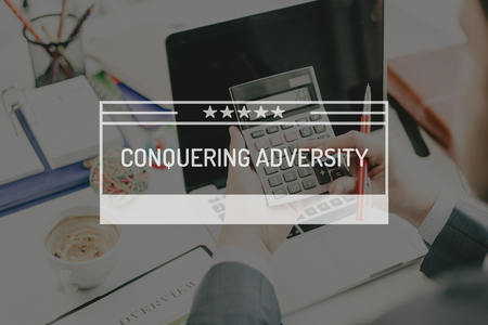 conquering: BUSINESS CONCEPT: CONQUERING ADVERSITY Stock Photo