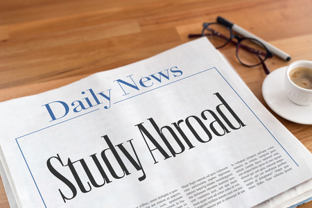 Study Abroad headlined newspaper on the table Stock Photo