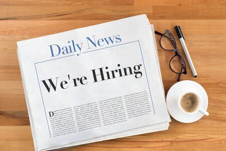 were: Were Hiring headlined newspaper on the table Stock Photo
