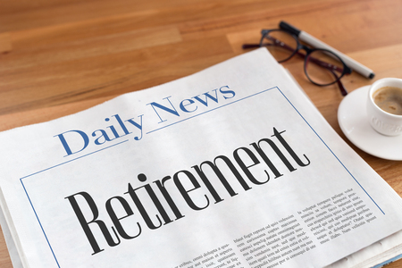 layoff: Retirement headlined newspaper on the table