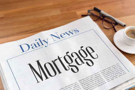 creditworthiness: Mortgage headlined newspaper on the table