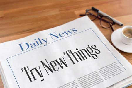 place of employment: Try New Things headlined newspaper on the table Stock Photo