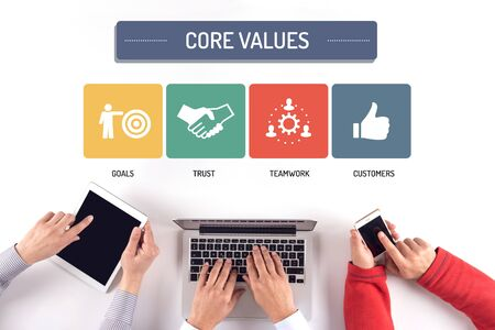 BUSINESS TEAM WORKING ON CORE VALUES CONCEPT Stock Photo