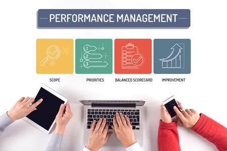 overruns: BUSINESS TEAM WORKING ON PERFORMANCE MANAGEMENT CONCEPT