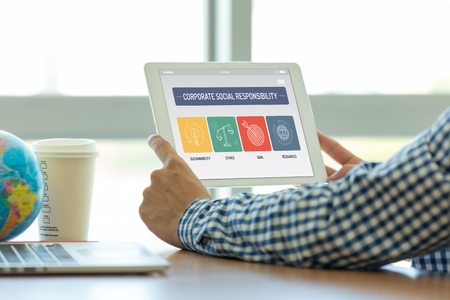 CORPORATE SOCIAL RESPONSIBILITY CONCEPT ON TABLET SCREEN