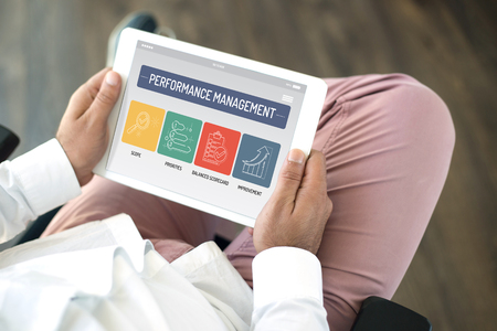 PERFORMANCE MANAGEMENT CONCEPT ON TABLET SCREEN