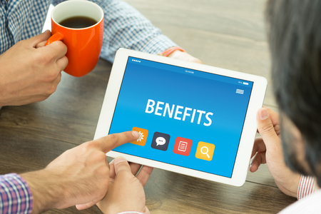 perks: BENEFITS CONCEPT ON TABLET PC SCREEN Stock Photo