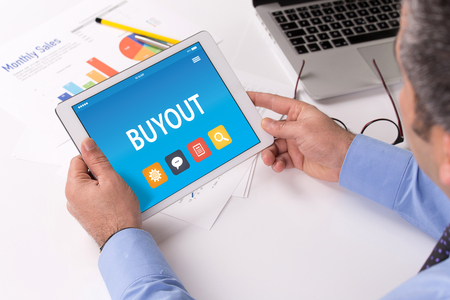 threw: BUYOUT CONCEPT ON TABLET PC SCREEN Stock Photo