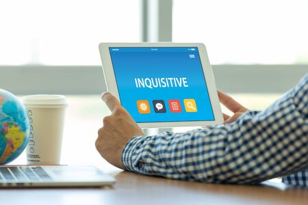 INQUISITIVE CONCEPT ON TABLET PC SCREEN Stock Photo