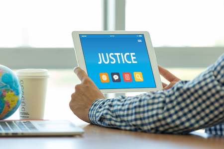 JUSTICE CONCEPT ON TABLET PC SCREEN Stock Photo