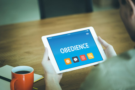 obedience: OBEDIENCE CONCEPT ON TABLET PC SCREEN Stock Photo