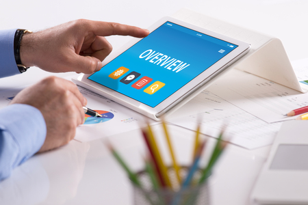 OVERVIEW CONCEPT ON TABLET PC SCREEN Stock Photo