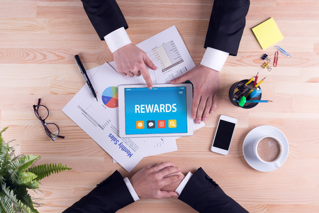 perks: REWARDS CONCEPT ON TABLET PC SCREEN Stock Photo