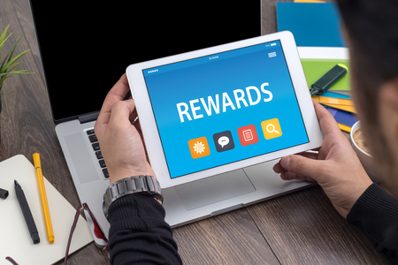 compensate: REWARDS CONCEPT ON TABLET PC SCREEN Stock Photo