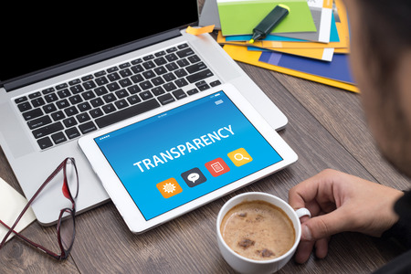 apparent: TRANSPARENCY CONCEPT ON TABLET PC SCREEN Stock Photo