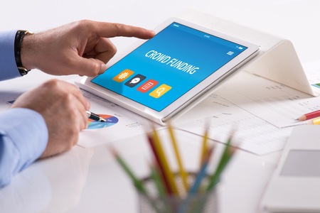 CROWD FUNDING CONCEPT ON TABLET PC SCREEN