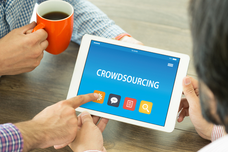 crowd source: CROWDSOURCING CONCEPT ON TABLET PC SCREEN