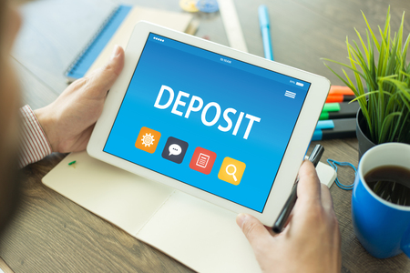 DEPOSIT CONCEPT ON TABLET PC SCREEN Stock Photo