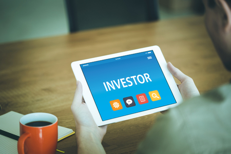 brokerage: INVESTOR CONCEPT ON TABLET PC SCREEN