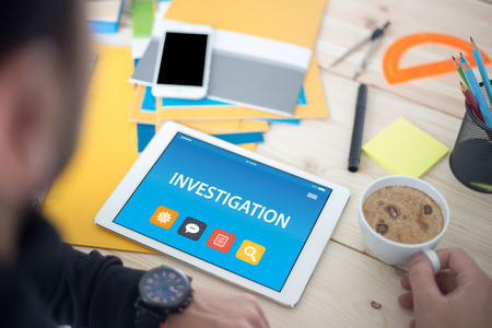 detective agency: INVESTIGATION CONCEPT ON TABLET PC SCREEN