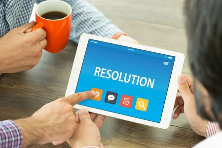 RESOLUTION CONCEPT ON TABLET PC SCREEN Stock Photo