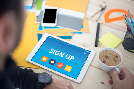 registry: SIGN UP CONCEPT ON TABLET PC SCREEN Stock Photo