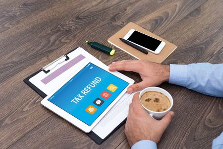 repayment: TAX REFUND CONCEPT ON TABLET PC SCREEN