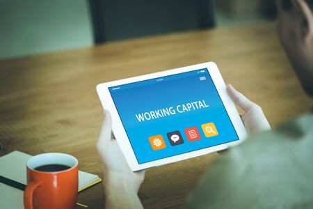 WORKING CAPITAL CONCEPT ON TABLET PC SCREEN Stock Photo
