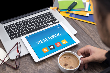 were: WERE HIRING CONCEPT ON TABLET PC SCREEN Stock Photo
