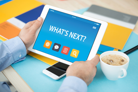 what's ahead: WHATS NEXT? CONCEPT ON TABLET PC SCREEN Stock Photo