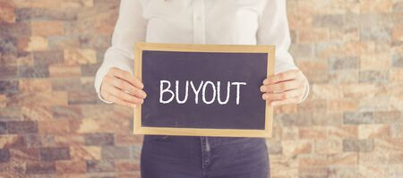 acquiring: BUYOUT CONCEPT Stock Photo