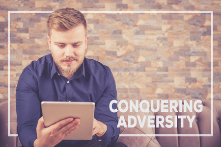 adversity: CONQUERING ADVERSITY CONCEPT Stock Photo