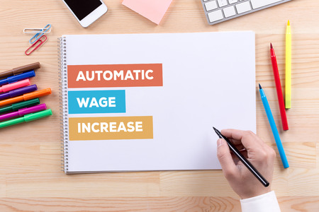 wage: AUTOMATIC WAGE INCREASE CONCEPT Stock Photo