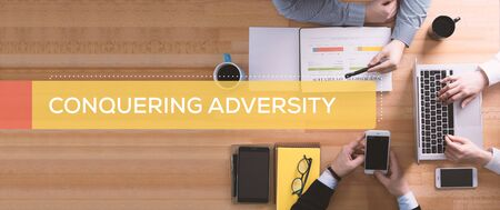 conquering: CONQUERING ADVERSITY CONCEPT Stock Photo