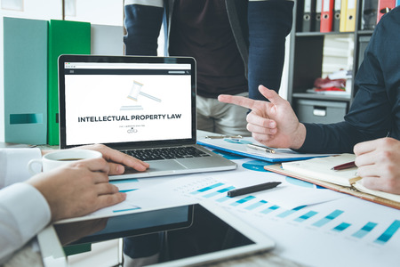 INTELLECTUAL PROPERTY LAW CONCEPT Stock Photo - 79810095