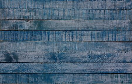 worn and old blue wooden background. Made with a stripping procedure, first a matt white color and a sanded matt cobalt blue finish, to give this pleasant result. Ideal for backgrounds.