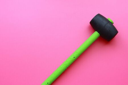 hammer or small mallet made of special rubber for plating, tiling or paving, basic construction tools.