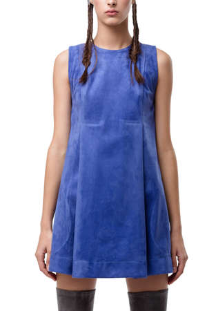 Young lady standing in blue suede dress on white background isolated