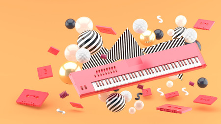 Reed piano keyboard and red tape amidst colorful balls on an orange background.-3d render.