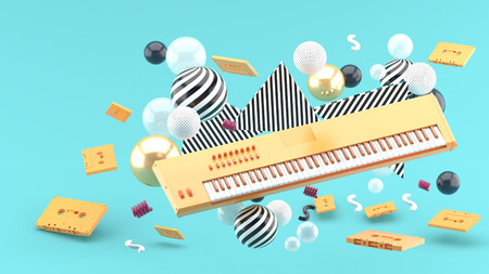 Orange piano keyboard and orange tape amidst colorful balls on a blue background.-3d render.