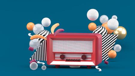 Red radio amidst colorful balls on a blue  background.-3d render. Reklamní fotografie