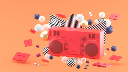 Red radio amidst colorful balls on an orange background.-3d render. Stock Photo