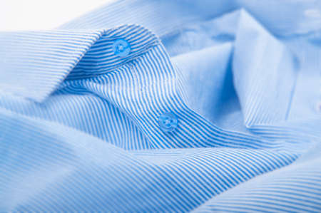 whitw: Buttons down shirt macro on whitw background Stock Photo